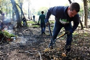 volunteers cleanup parks at backyard nature center